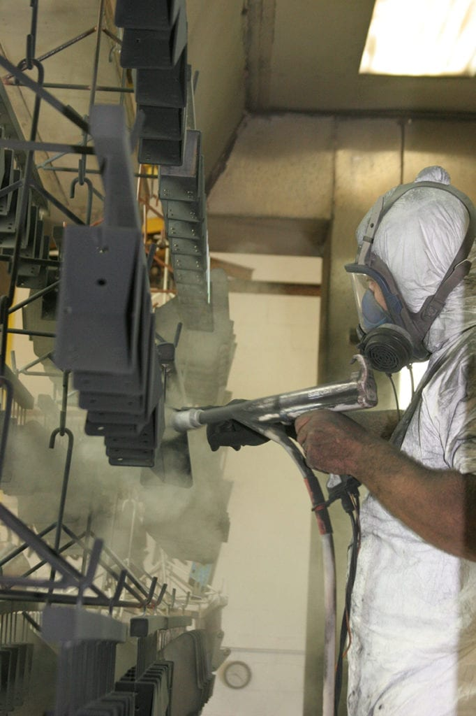 technician spraying product