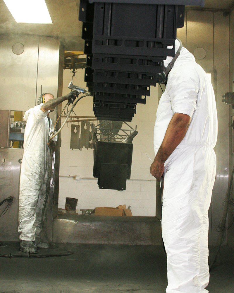 spraying product as it enters oven